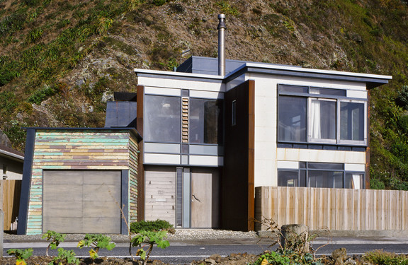 residential architecture national award winning New Zealand architect precast concrete timber Breaker Bay coastal Wellington southern coast crafted detailed elegant handsome builder Tim Nees NZIA recycled material plywood rusted steel plastic cladding