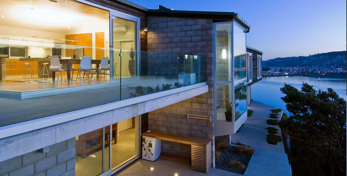 residential architecture award winning New Zealand architect concrete timber plywood southern coast crafted detailed elegant handsome builder Wellington staircase detail Tim Nees NZIA beach low budget Seatoun renovation alteration extension kitchen Maupuia Evans Bay harbour