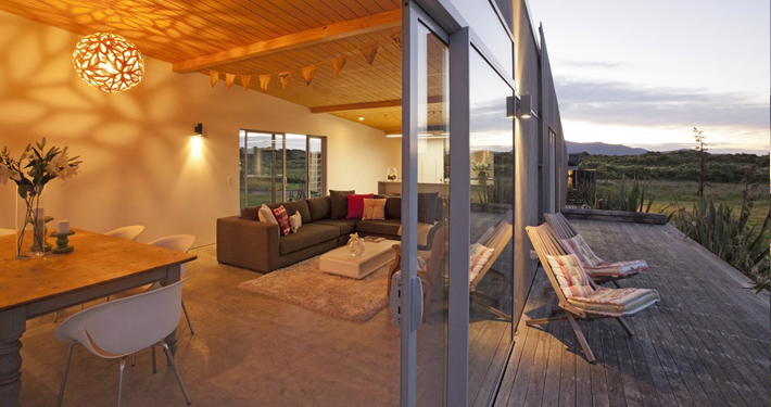 residential architecture award winning New Zealand architect concrete timber plywood Kapiti coast crafted detailed elegant handsome builder Wellington southern bedroom detail Tim Nees NZIA steps Peka peak beach low budget cheap slats