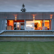 residential architecture award winning New Zealand architect concrete timber plywood Mana coast crafted detailed elegant handsome builder Wellington Porirua verandah detail Tim Nees NZIA sliding screen outdoor room living room space courtyard beach coastal